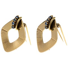 Tiffany & Co. Clip Brooches in 14 Karat Gold and Sapphires, New York, circa 1950