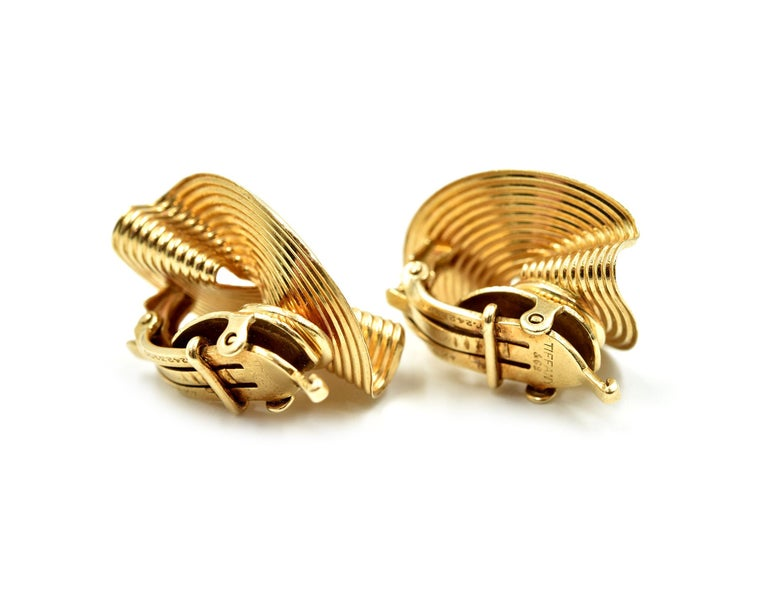 Designer: Tiffany & Co Material: 14k yellow gold Dimensions: each earring measures 1 inches long and 3/4 inches wide Fastenings: clip-ons Weight: 8.50 grams