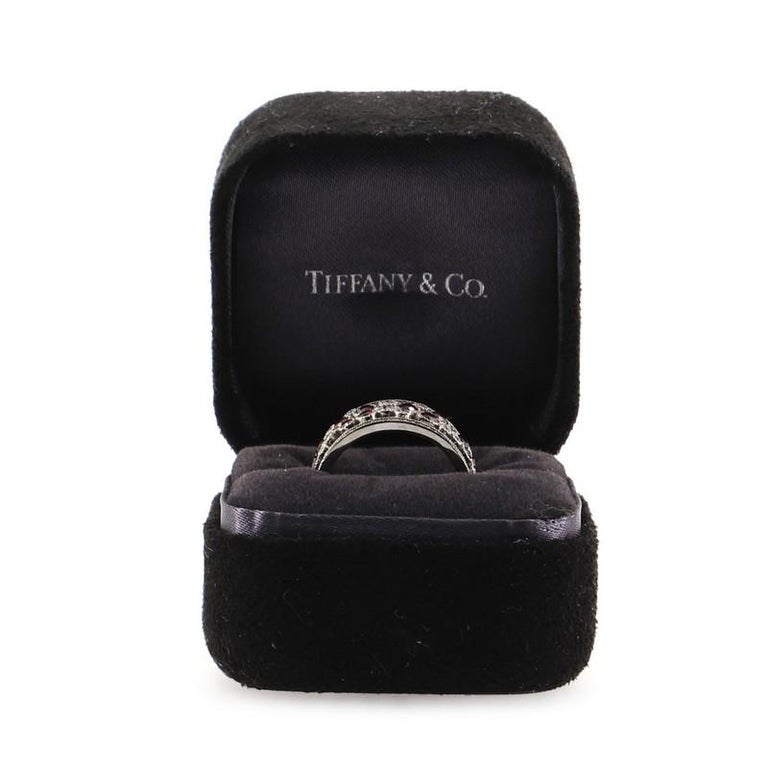 Condition: Very good. Shows signs of moderate scratches throughout. Accessories: No Accessories Measurements: Size: 6.5, Width: 9.8 mm Designer: Tiffany & Co. Model: Cobblestone Band Ring Platinum with Diamonds and Rubies 9.5mm Exterior Material:
