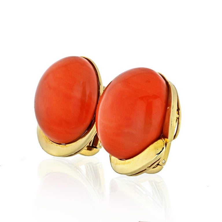 Round Coral measures 22.6mm, entire earring measures 25.6mm. Coral is of vibrant orange color.  Clip on closure.