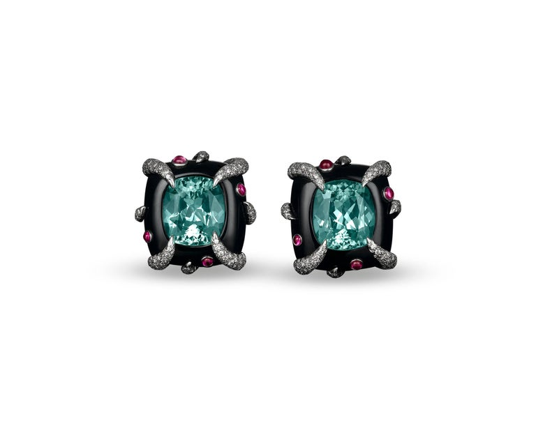 Two fabulous green tourmalines star in this enchanting pair of Tiffany & Co. earrings. Weighing 17.34 total carats, these rare gems sparkle in their sumptuous black onyx settings. Adding to the magnificent aquatic-inspired design are eight pink