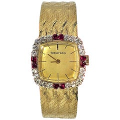 Tiffany & Co. Cushion Shaped Diamond and Ruby Bezel Watch in Yellow Gold