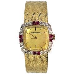 Tiffany & Co. Cushion Shaped Diamond and Ruby Bezel Watch in Yellow Gold