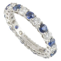 Tiffany & Co. Diamond and Sapphire Platinum Embrace Eternity Ring