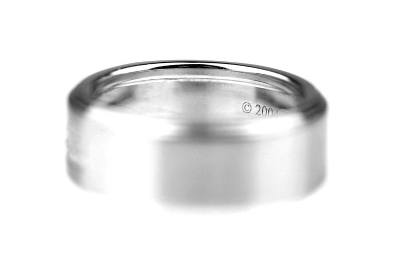 18 carat white gold diamond set band ring by Tiffany & Co. British hallmarked London 2005, sponsor mark