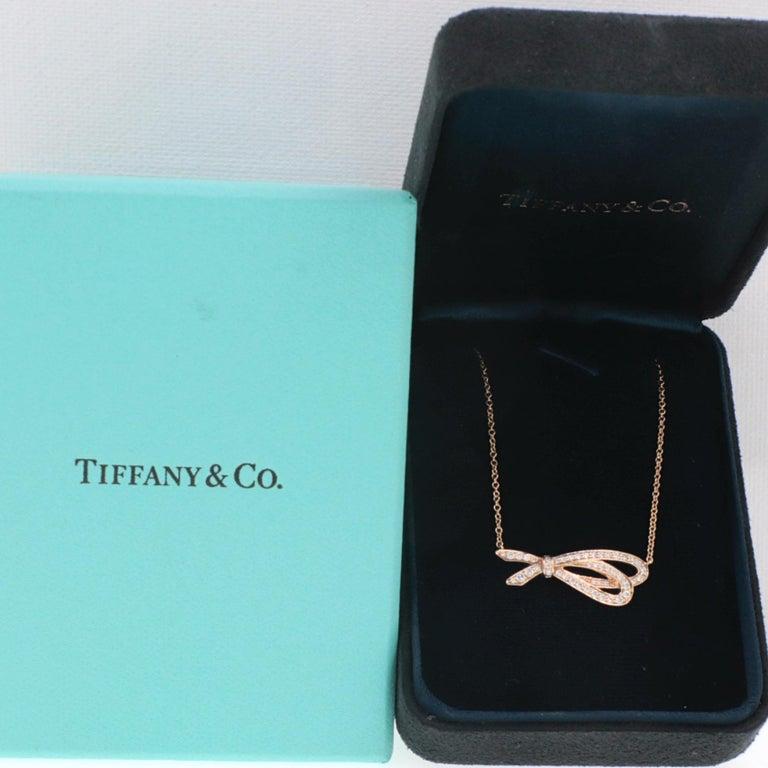 Tiffany & Co. Necklace Style:  Diamond Bow Pendant Necklace  Gold:  18K Rose Gold TCW:  0.37 Carat Total Diamond:  44 Round Brilliant Cut Diamonds Color & Clarity:  G Color, VS1 Clarity Hallmark:  Tiffany&Co. AU750 Includes:  Tiffany Pendant Box,