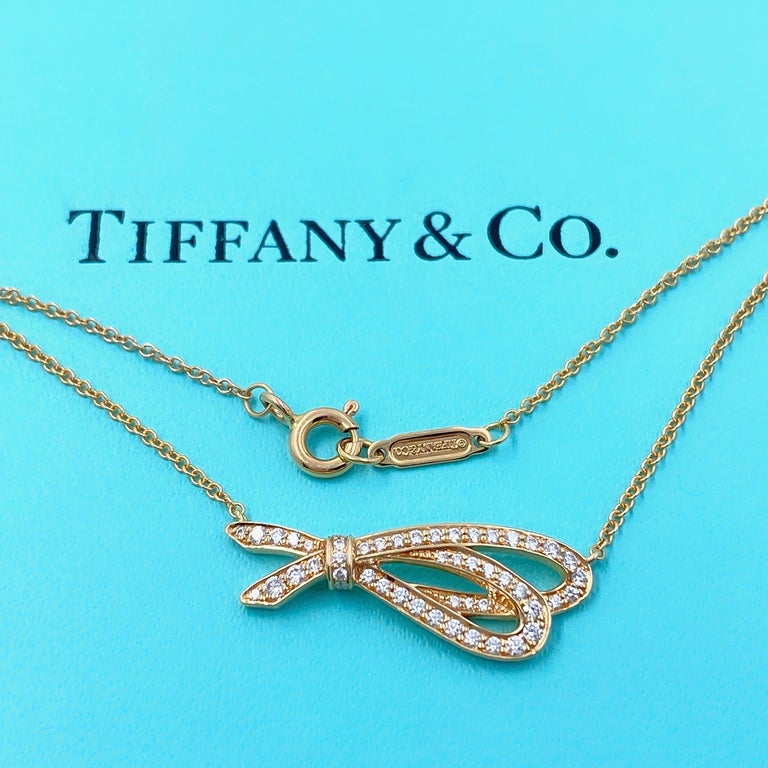 Tiffany & Co. Diamond Bow Pendant Necklace 18 Karat Rose Gold In Excellent Condition For Sale In San Diego, CA