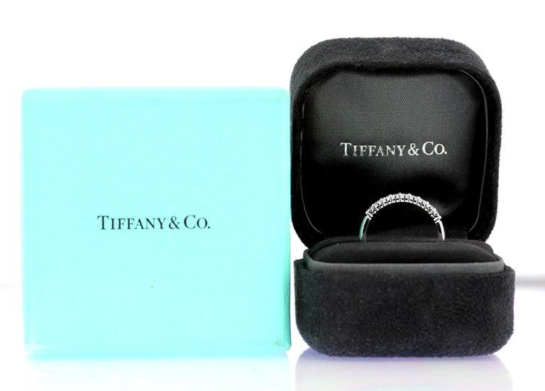 A diamond half eternity ring set in platinum by Tiffany, British Hallmarked London 2012, sponsor mark