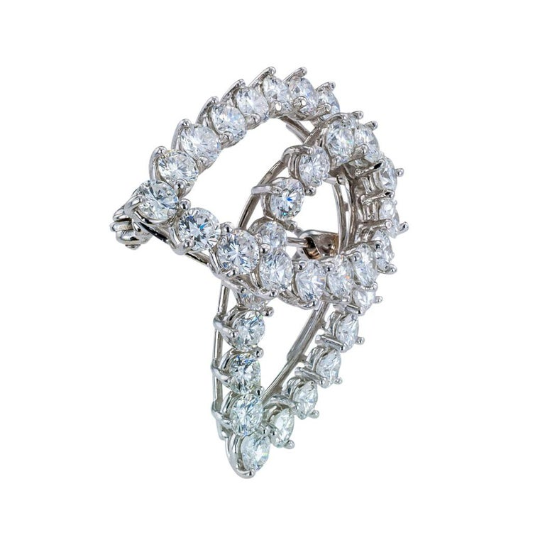 Tiffany & Co diamond and platinum abstract swirl brooch circa 1980.  Love it because it caught your eye, and we are here to connect you with beautiful and affordable jewelry.  Decorate Yourself!  Simple and concise information you want to know is