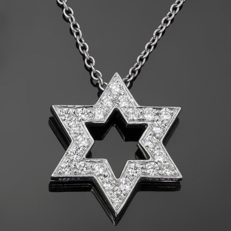 This classic Jewish-themed Tiffany & Co. necklace features a Star of David pendant crafted in 950 platinum and pave-set with brilliant-cut round E-F VVS1-VVS2 diamonds of an estimated 0.24 carats. Made in United States circa 2010s. Measurements: