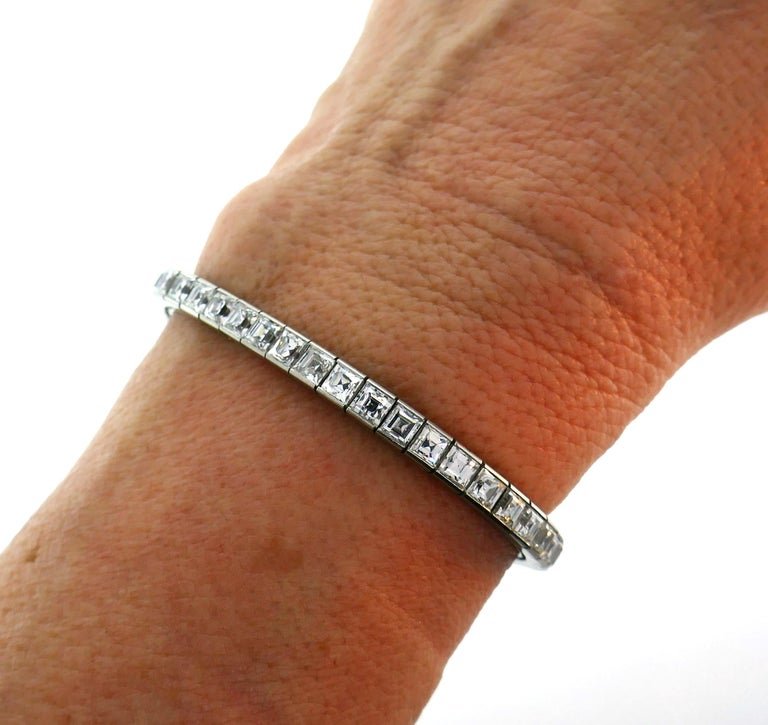 Stunning diamond and platinum tennis bracelet created by Tiffany & Co. in the 1950s. The bracelet features forty-four perfectly selected matching square step cut diamonds of H-I color, VS clarity and total weight approximately 14.28 carats.  The