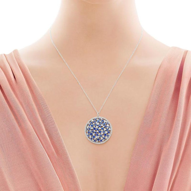 This exquisite medallion pendant necklace by Tiffany & Co is full of dazzling round sapphires and round brilliant diamonds. This pendant comes on an 18