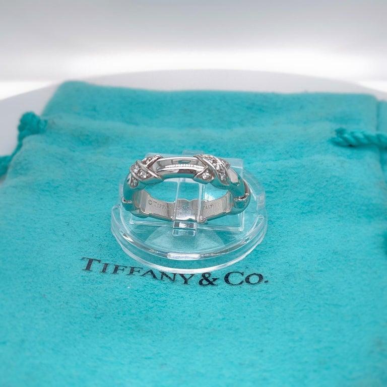 Tiffany & Co Style:  Signature X Diamond Ring Metal:   18 kt White Gold TCW:  0.15 tcw Main Diamond:  Round Brilliant Cut Diamonds Color & Clarity:  F - VS Hallmark:  ©TIFFANY&CO.750 Italy Includes:  T&C Jewelry Pouch Retail: