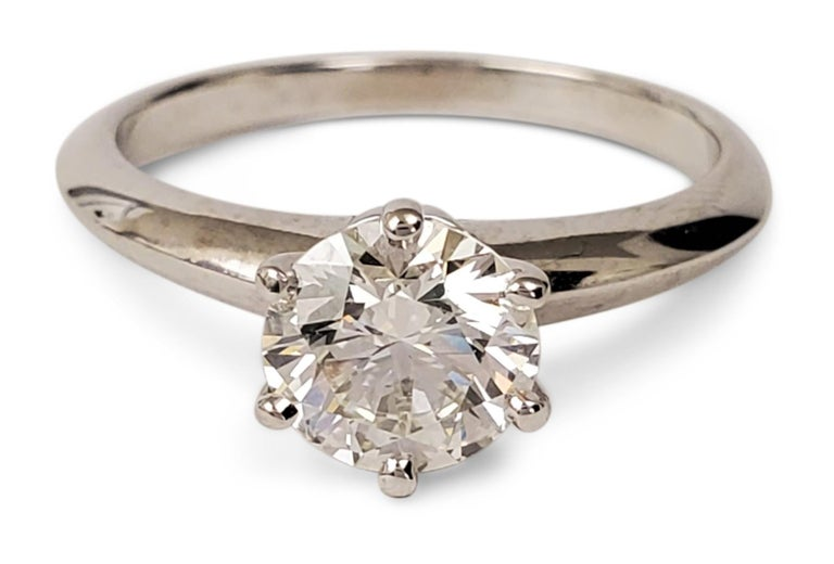 Authentic Tiffany & Co. engagement ring made in platinum set with a stunning 1.06ct round brilliant cut diamond, I color, VS1 clarity.  Cut and polish are graded Excellent. The symmetry is graded as Very Good and there is no fluorescence.  Stamped