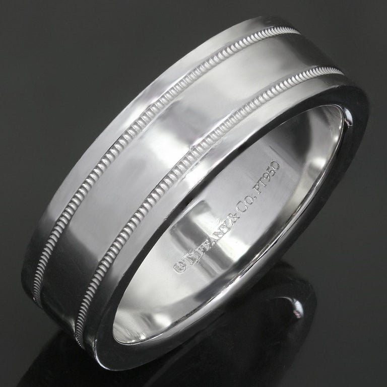 This fabulous Tiffany & Co. unisex wedding band is crafted in fine platinum and elegantly accented with milgrain edges. Classic and timeless.  Made in United States circa 2010s. Measurements: 0.23
