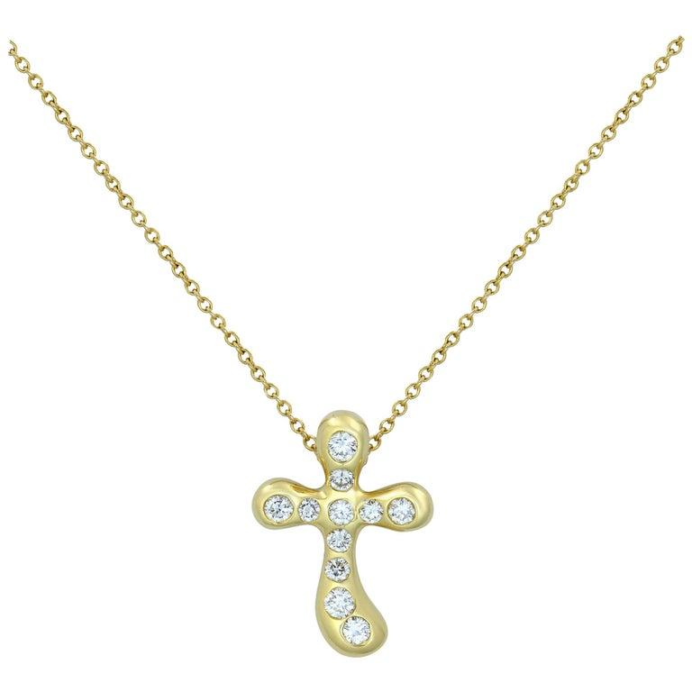 Tiffany & Co. Elsa Peretti 18 Karat Yellow Gold Diamond Cross Pendant 0.25 Carat For Sale