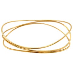 Tiffany & Co. Elsa Peretti 18 Karat Yellow Gold Three Wave Bangle Bracelet