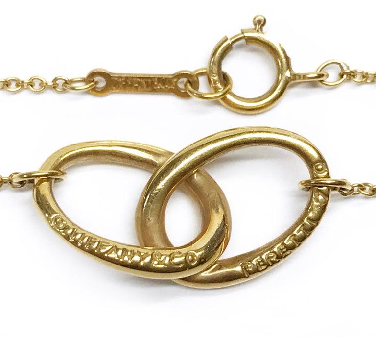 Modern Tiffany & Co. Elsa Peretti 18K Vintage Gold Interlocking Ovals Pendant Necklace For Sale