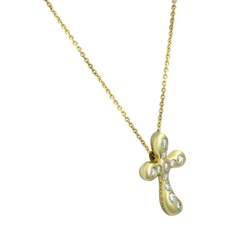 Modern Tiffany & Co. Elsa Peretti 18 Karat Yellow Gold Diamond Cross Pendant 0.25 Carat For Sale