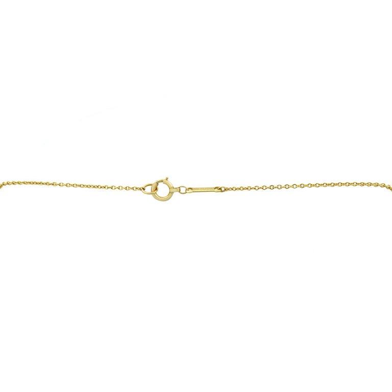 Tiffany & Co. Elsa Peretti 18 Karat Yellow Gold Diamond Cross Pendant 0.25 Carat In Excellent Condition For Sale In New York, NY