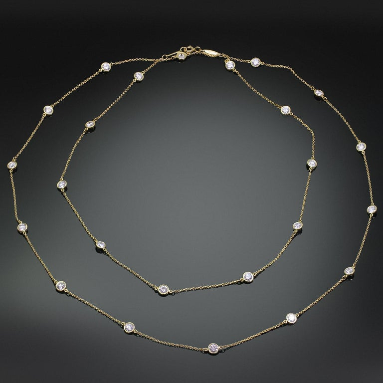 This long and elegant Tiffany & Co. necklace designed by Elsa Peretti for the iconic By The Yard collection is crafted in platinum and bezel-set with 24 round brilliant F-G VS1 diamonds weighing an estimated 4.32 carats. Made in United States circa