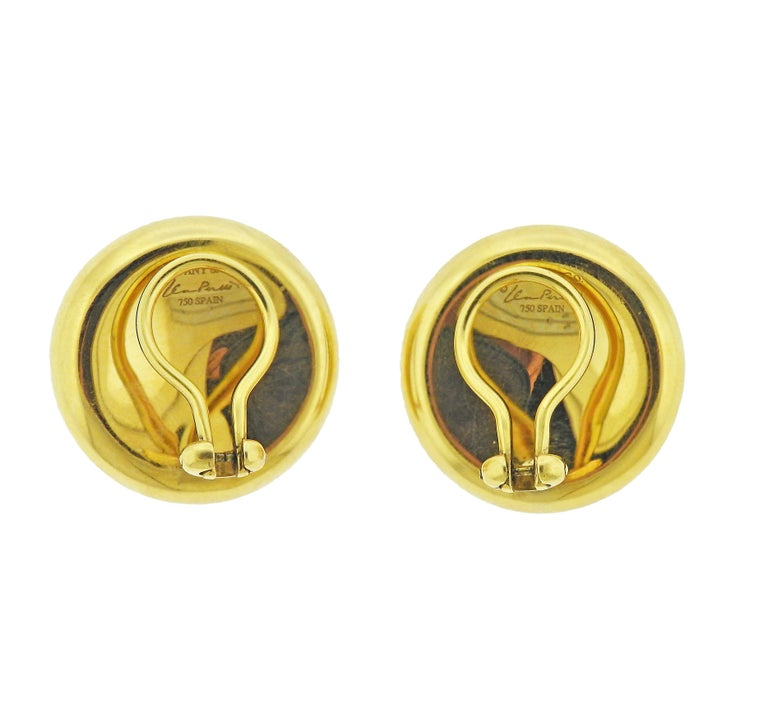 Pair of 18k gold indented design earrings, by Elsa Peretti for Tiffany & Co. Earrings are 23mm in diameter. Marked: Tiffany & Co, Elsa Peretti, Spain, 750. Weight - 17 grams.