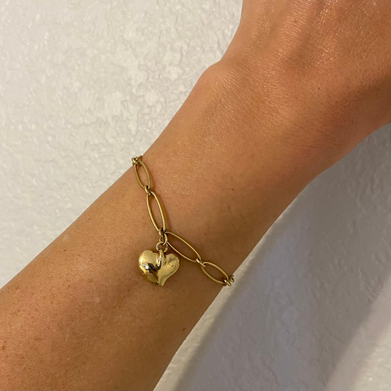 """Iconic TIFFANY & CO Elsa Peretti 18K Yellow Gold open Link Bracelet, suspending a Heart Charm. Marked:  Tiffany & Co. 750 and signed: Elsa Peretti SPAIN. Measuring approx. 7""""l x 0.20""""w. For that Special Someone…including you!"""