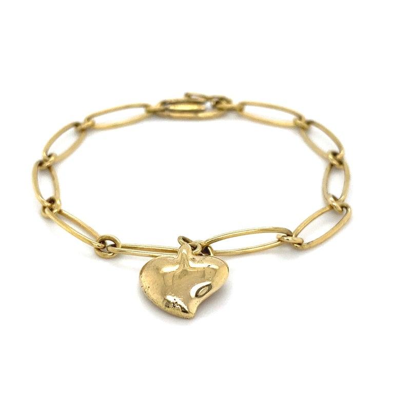 Modernist TIFFANY & CO Elsa Peretti Gold Heart Charm Bracelet Estate Fine Jewelry For Sale