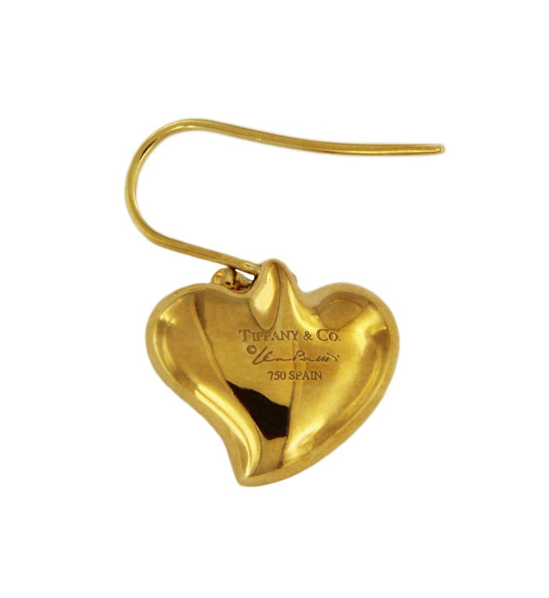 "TIFFANY & CO. ELSA PERETTI GOLD HEART DROP EARRINGS  -Condition: Mint  -Material: 18k Yellow Gold -Heart dimension: 12x14mm -Weight: 9.4gr -Hallmarked: ""Stamped 750 and Spain"" Comes with Tiffany pouch."