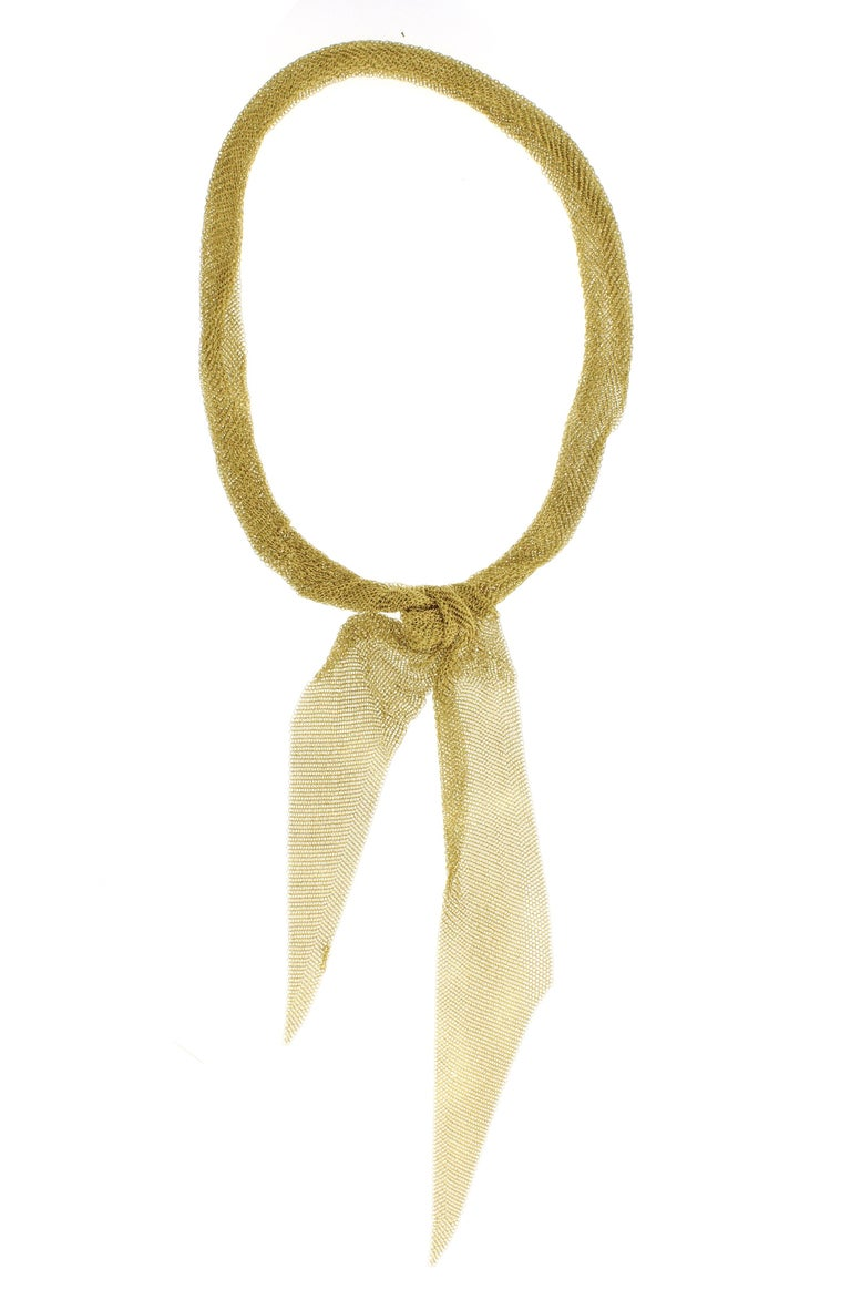 This 18 karat large mesh scarf necklace by Elsa Peretti is malleable and ergonomic in the way it drapes over the body's contours. 1¾  inches wide, 38 inches long, 87 grams