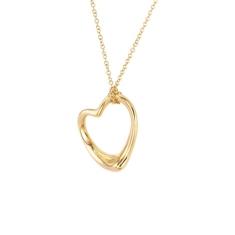 Tiffany & Co Elsa Peretti yellow gold open heart-shaped pendant.  Clear and concise information you want to know is listed below.  Contact us right away if you have additional questions.  We are here to connect you with beautiful and affordable
