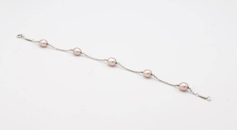 Tiffany & Co. Elsa Peretti Pearls By The Yard Sterling Silver Freshwater Cultured 5 Pearl Station Bracelet  Metal: Sterling Silver Weight: 3.48 grams Length: 7.25 inches  Pearls: Approx. 6.5mm, pinkish white hue  Signed: