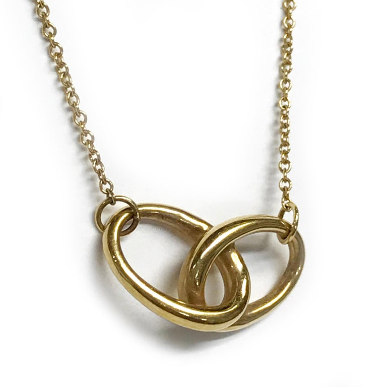 Modern Tiffany & Co. Elsa Peretti Vintage Gold Interlocking Ovals Pendant Necklace For Sale