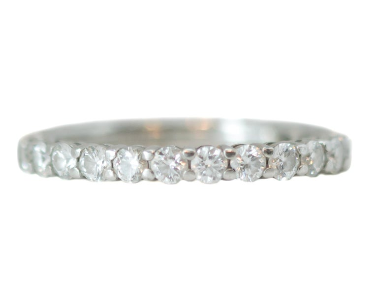 Tiffany and Co. Embrace Band Ring - Platinum, Diamonds  Features: 2.2 millimeter Band 0.78 carat total weight Round Brilliant Diamonds Full circle of diamonds Platinum setting Ring fits a size 4   Ring Details: Size: 4 Width: 2.2 millimeters Metal: