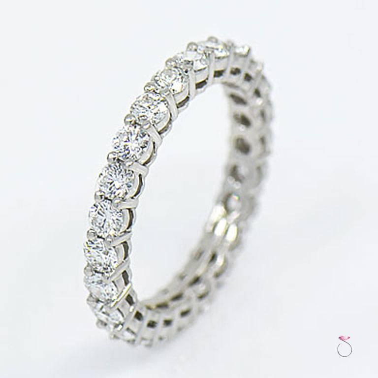 Tiffany & Co. Embrace diamond eternity Band in platinum with round brilliant diamonds all around. This is a 3.00 mm wide eternity band size 7.50. 24 Round brilliant cut diamonds, Totaling approximately 1.96 ct. individually set in shared four