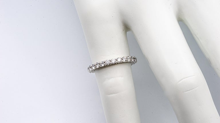 Tiffany Embrace Eternity Band Ring finely crafted in Platinum with round cut brilliant diamonds ranging E-F color VS clarity  Designer: Tiffany & Co. Metal: Platinum Purity: 950 Ring Size: 4 Width: 2.2 mm Total number of Diamonds : 25 Total Carat