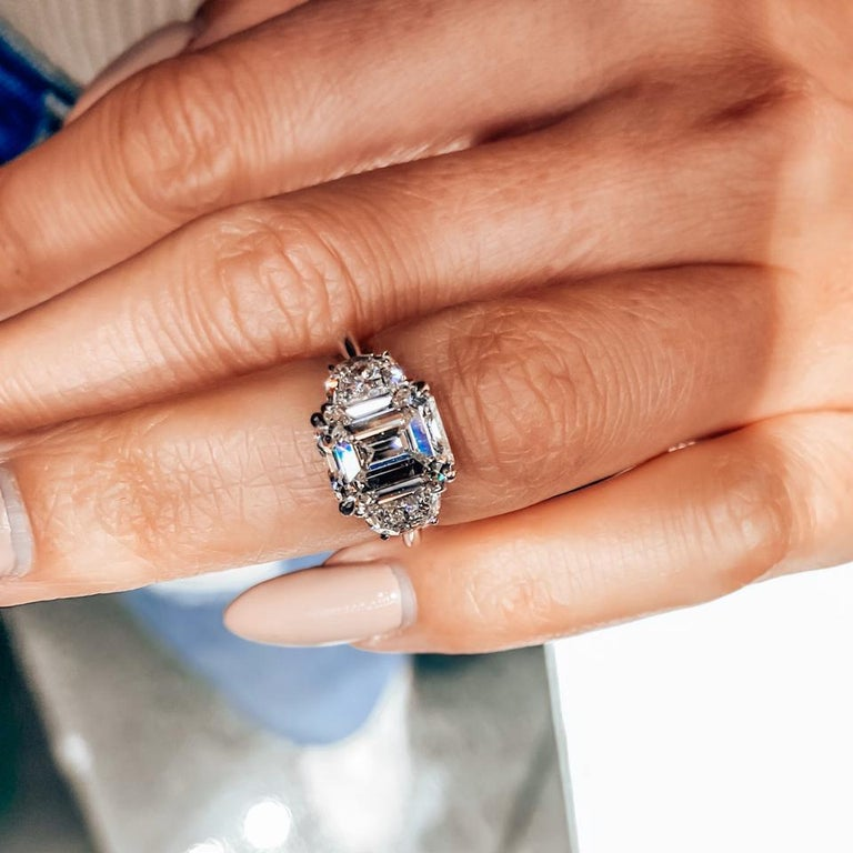 3.33ct Emerald Cut Three Stone Diamond Engagement Ring  Excellent condition this three stone diamond engagement ring is a very small ring size US 3.5. And can be sized up or down half a size.  DETAILS: Mounted with a stunning 3.33ct F color diamond
