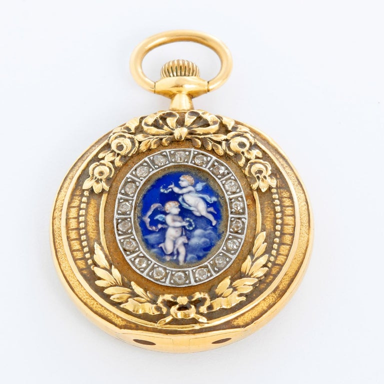 Tiffany & Co. Enameled 14K Yellow Gold Pocket Watch Brooch - Manual winding. 14K yellow gold; reverse pictures an impeccably executed enamel of two angels with diamonds surrounded ( 27.4 mm ). White dial with a double sunk dial with Arabic numerals