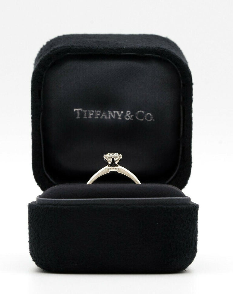 Tiffany & Co. Diamond Engagement ring with Tiffany & Co. Hallmark, featuring a .46 ct Center, graded H color , and VVS1 Clarity, in Platinum. Crown Inscription: T&Co. 012130441 Signed: Tiffany & Co Stamped: 32847064 , D.046CT, PT950 Includes