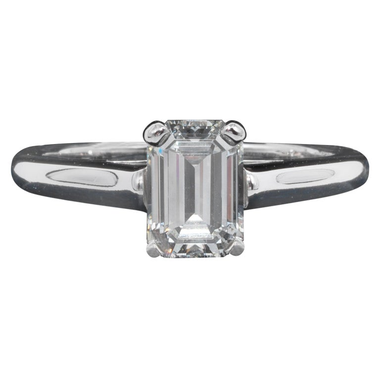 Tiffany & Co. Diamond Engagement Solitaire signed by Tiffany & Co. featuring a 1.07 ct Emerald Cut Center, graded by Tiffany,  I color , and VS2 Clarity. In Platinum Includes Original Tiffany Certificate and Box Diamond registration #: D11247  Ring