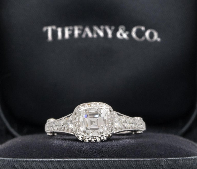 Tiffany Legacy® Engagement Ring with a Diamond Band signed by Tiffany & Co. featuring a 1.18 ct Cushion-Cut Center, graded D color , and VVS1 Clarity, in Platinum.  Includes Original Tiffany Certificate,  and Box Retail Appraisal from Tiffany & Co: