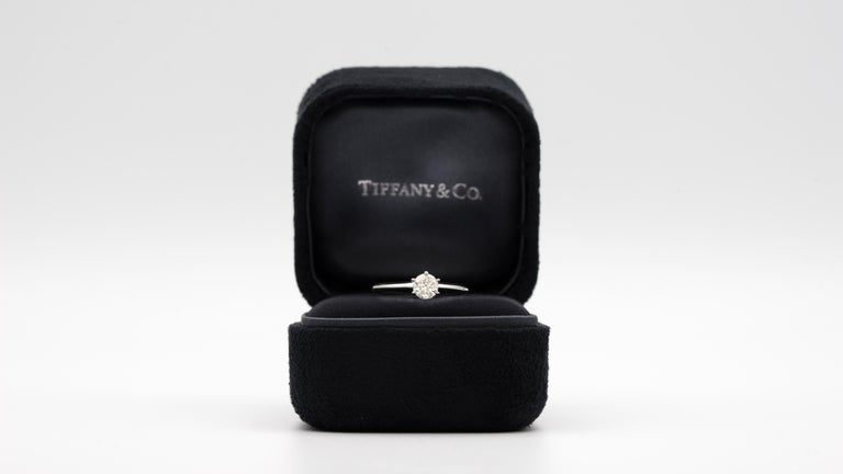 Tiffany & Co. Diamond Engagement Solitaire signed by Tiffany & Co. featuring a 1.28 ct Center, graded by Tiffany I color , and VS1 Clarity.  Brand : Tiffany & CO Ring type: Solitaire Center Diamond: 1.28 Carat Color / Clarity:  I VS1 Metal: