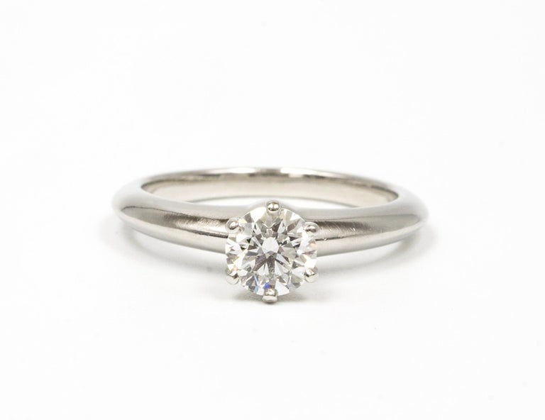 Tiffany & Co. Diamond Engagement Solitaire signed by Tiffany & Co. featuring a .66 ct Center, graded by Tiffany H color , and SI1 Clarity. In Platinum Includes Original Tiffany Certificate and Box Crown Inscription T&C L01140081   Retail Approx