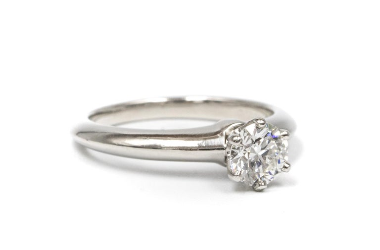 Contemporary Tiffany & Co. Engagement Ring with .66 Carat Round Brilliant Centre in Platinum For Sale