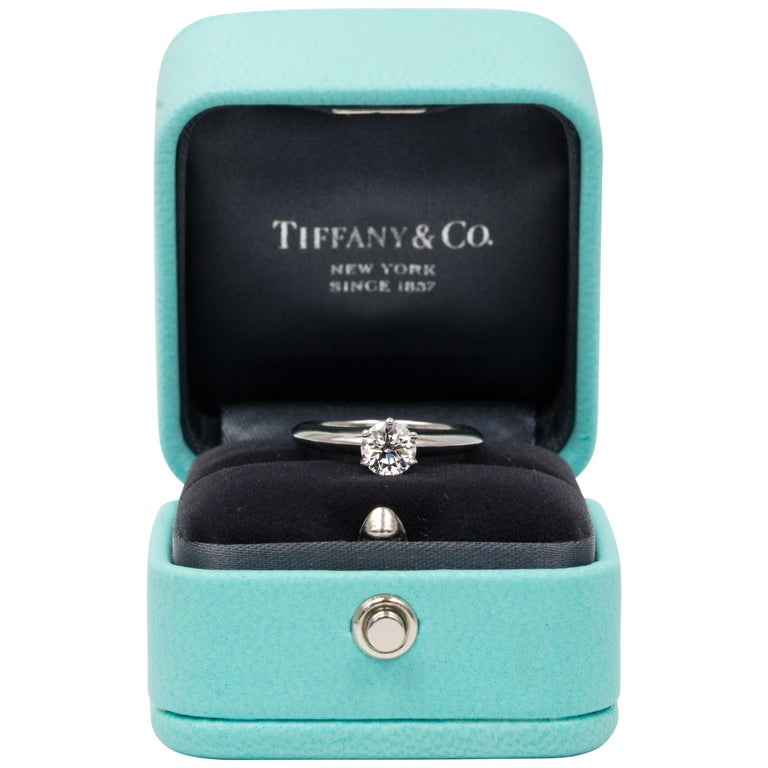 Tiffany & Co. Engagement Ring with .66 Carat Round Brilliant Centre in Platinum For Sale