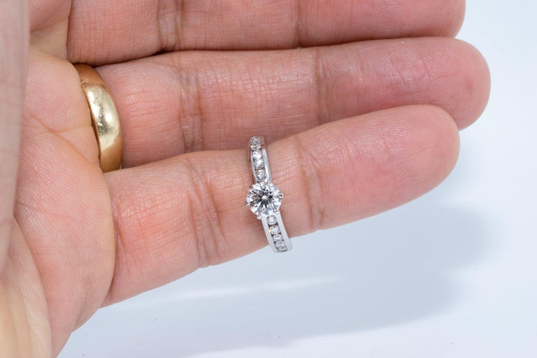 Tiffany & Co. Engagement Ring with .71 Carat Round Brilliant Centre in Platinum For Sale 2