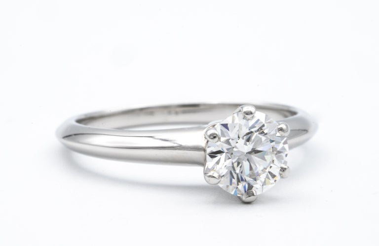 Tiffany & Co. Diamond Engagement Solitaire signed by Tiffany & Co. featuring a .92 ct Center, graded F color , and VS1 Clarity. In Platinum  Crown Inscription: T&Co. 19263363 Includes Original Tiffany Certificate and Box Current Retail from Tiffany