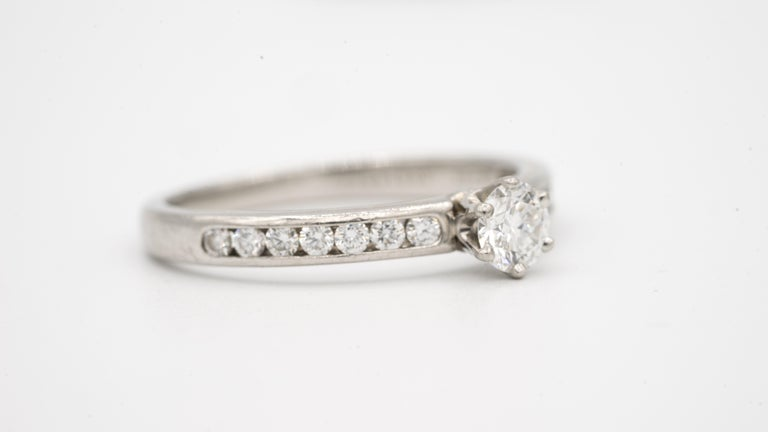 Contemporary Tiffany & Co. Engagement Ring with Channel-Set Diamond Band in Platinum For Sale