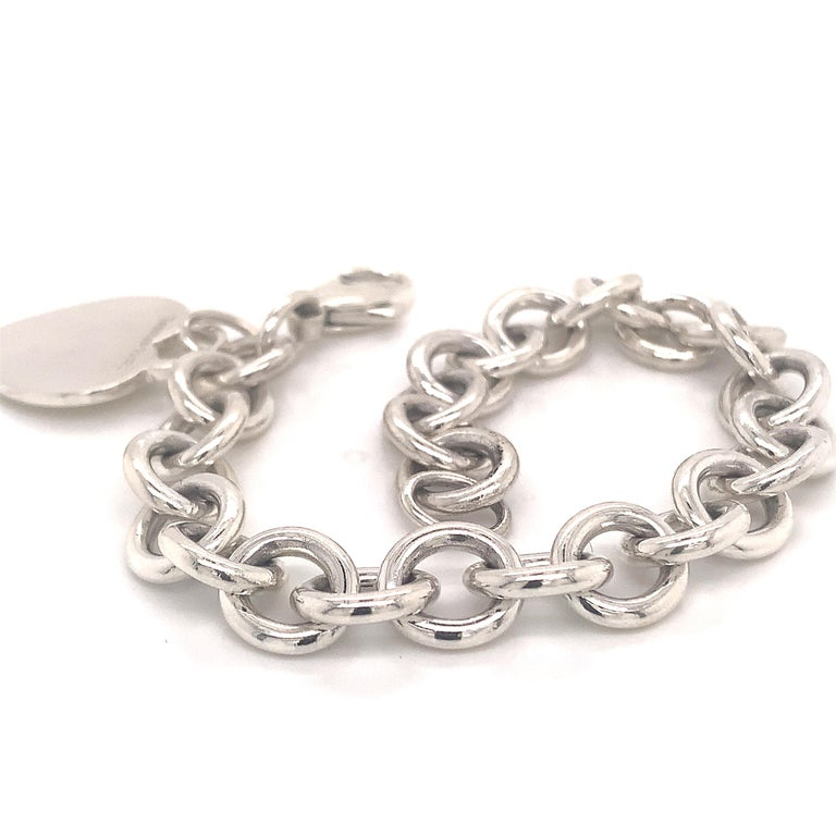 Tiffany & Co Estate Bracelet with Heart Charm 8 Inches Sterling Silver 36.2g TIF71   This elegant Authentic Tiffany & Co bracelet with heart charm is 8 inches in length.  TRUSTED SELLER SINCE 2002   PLEASE SEE OUR HUNDREDS OF POSITIVE FEEDBACKS FROM