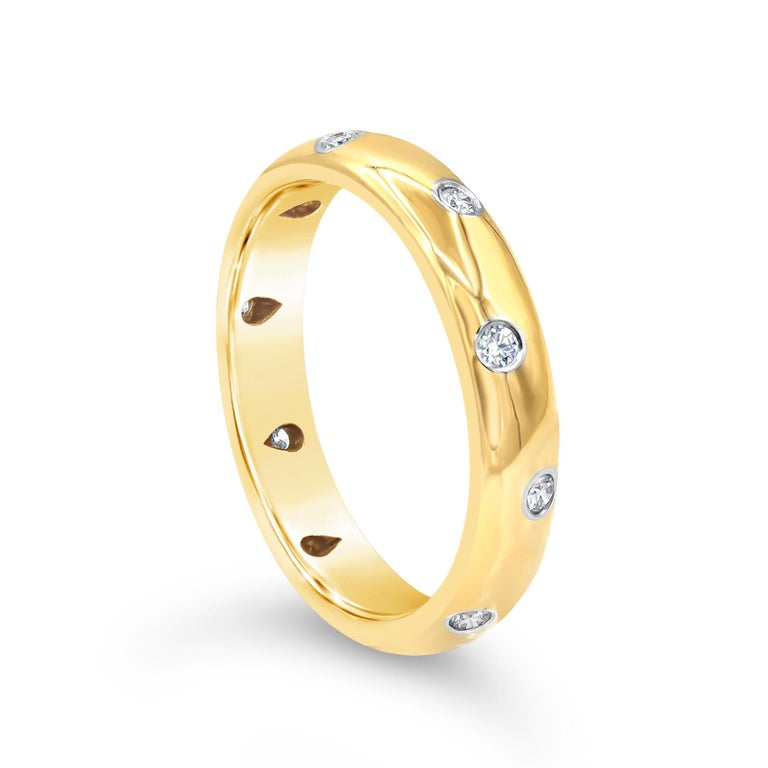 Showcasing round brilliant diamonds flush set in 18 karat yellow gold. Diamonds weigh 0.27 carats total. Made and Signed Tiffany & Co. Comes with original Tiffany & Co. box. Size 9.5 US.